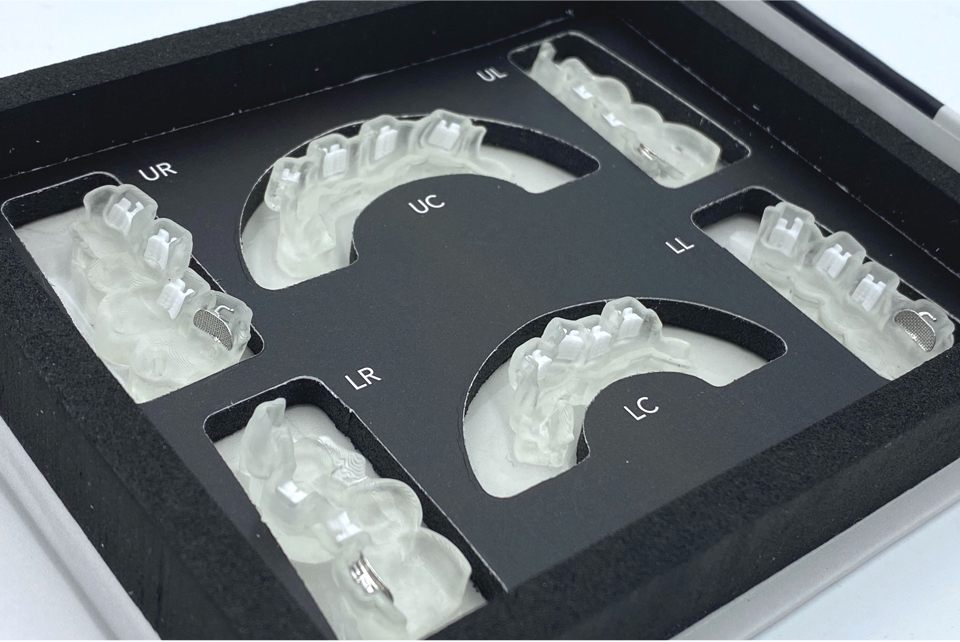 LightForce's dental brackets are delivered in a box and are ready to apply to the patient.